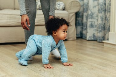 Crawling Baby with a Guardian